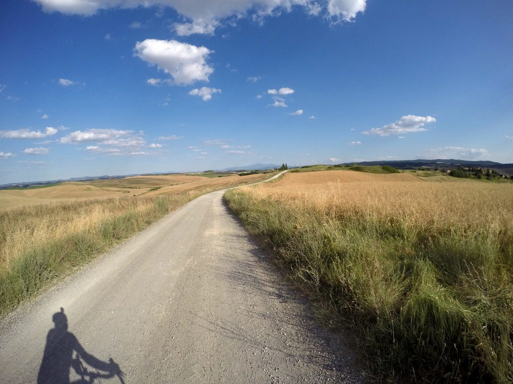 cycling on the white roads in tuscany